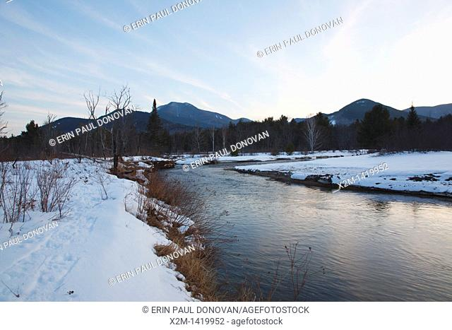 Sunset from along the Swift River during the winter months  This river travels along side of the Kancamagus Highway route 112 which is one of New England's...