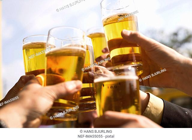 Hands with glasses of beer, Budapest, Hungary