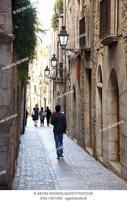 Tourists walking down Forca Street in Girona, Catalonia, Spain
