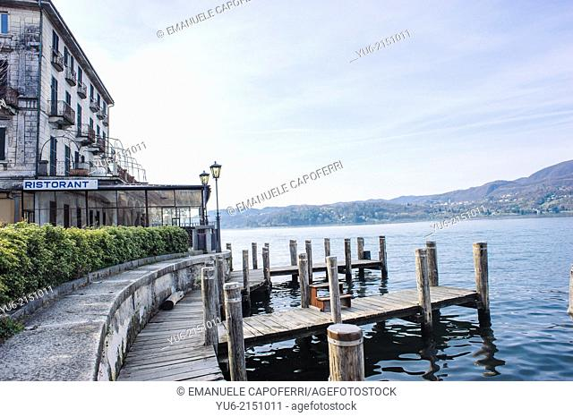 Lakefront with boat docking, village of Orta, Lake Orta, Piedmont, Italy
