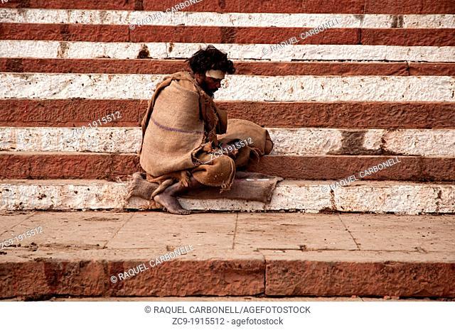 Man sitting on the ghats  Varanasi, Benares, Uttar Pradesh, India