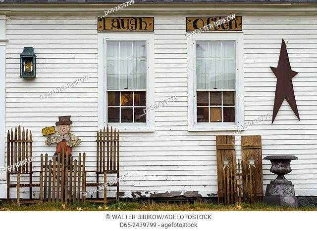 USA, New Hampshire, Lake Winnipesaukee Region, Moultonborough, antique shop with signs, laugh-often