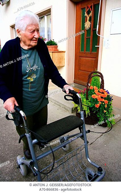 90 year old woman using walking frame. Switzerland