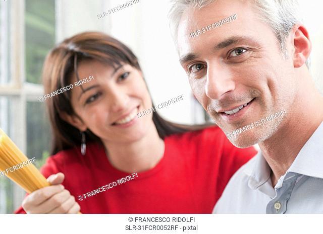 Portrait of happy couple cooking