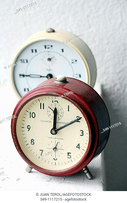 two alarm-clocks antique