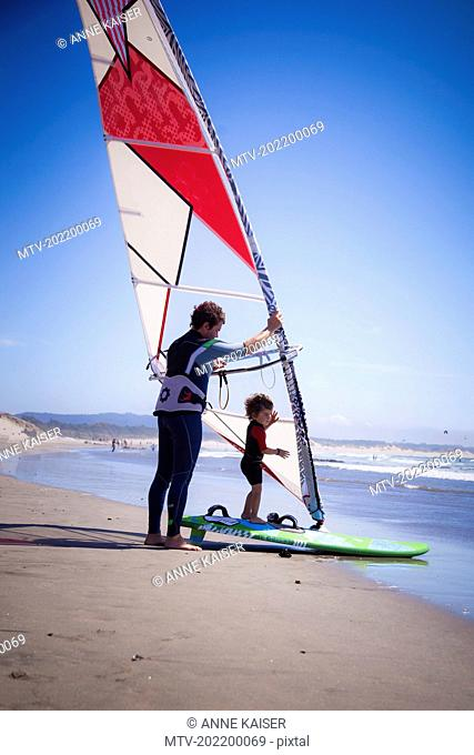 Father with his son windsurfing in the sea, Viana do Castelo, Norte Region, Portugal