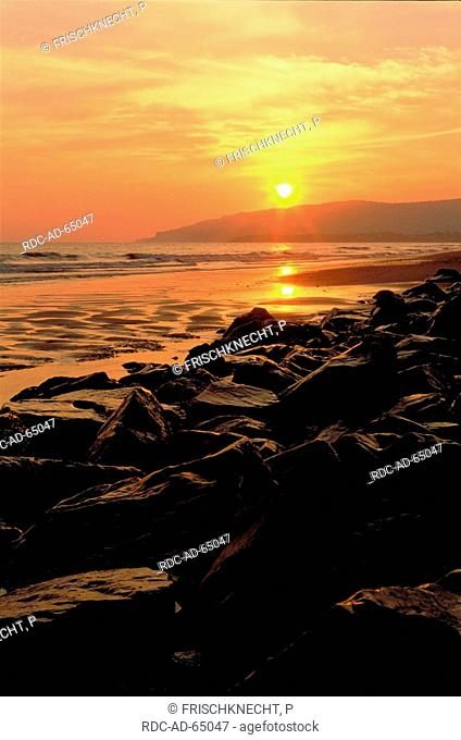 Sunset at rocky coast Kachemak Bay Homer Spit Alaska USA