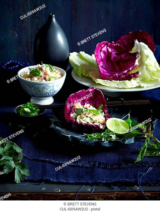 Chicken larb cabbage, served in red cabbage leaf