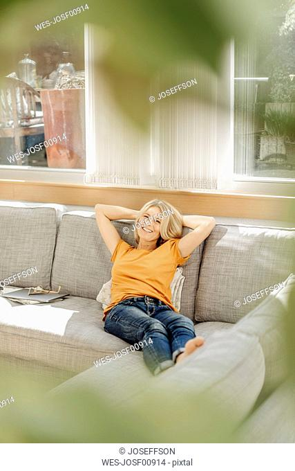Woman at home relaxing on couch