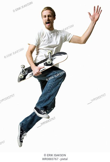 Portrait of a young man holding a skateboard