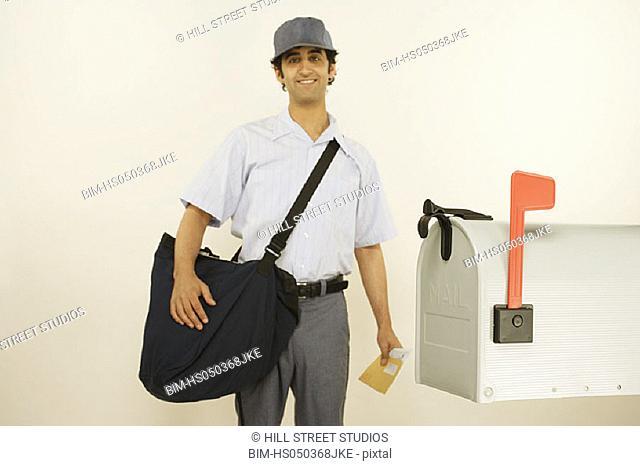 Postman standing near mailbox
