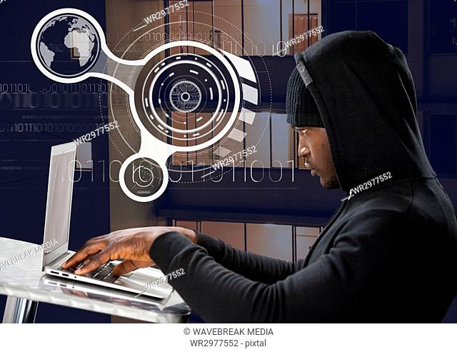 Side view of hacker using a laptop on a table in front of 3D digital background