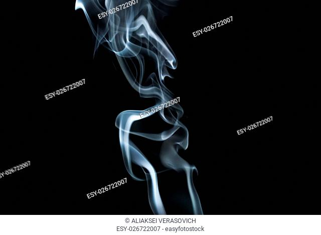Abstract smoke. Swirls of smoke on black background. Studio shot
