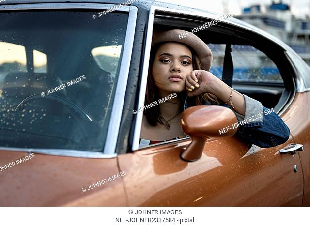 Teenage girl in car