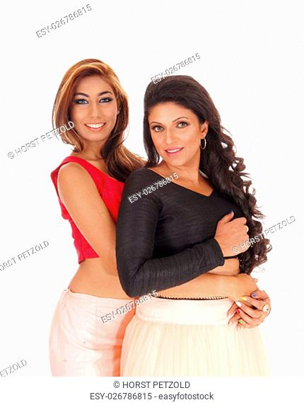 Two beautiful young woman standing waist up, the brunette hugging.the other one from behind, isolated for white background.