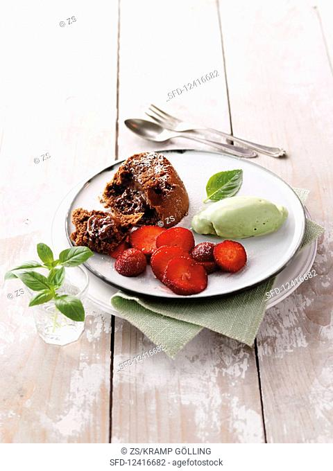 Chocolate cake and basil ice cream with strawberries