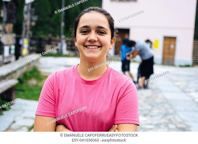 portrait of a 12 year old girl in the mountain village of the Alps