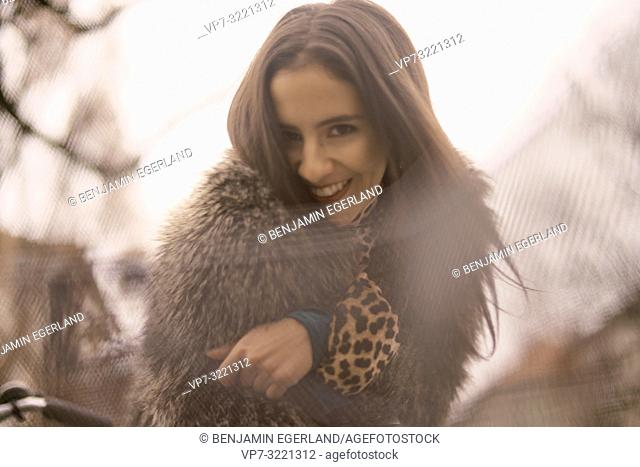 portrait of smiling woman, happiness, wearing fashionable coat, in Munich, Germany