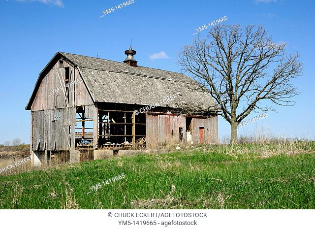 Abandoned run down barn on farm landscape