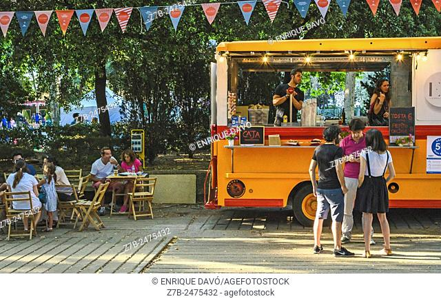 An orange van in Madrid eat event, Madrid city, Spain