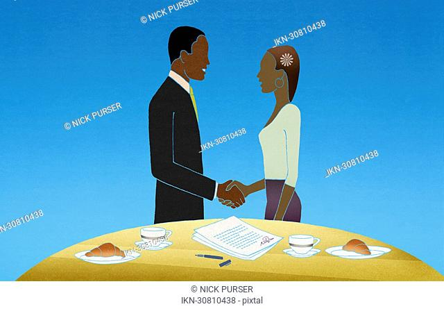 Consultant shaking hands with woman