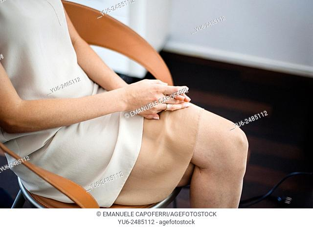 Detail of woman's body during preparation for wedding