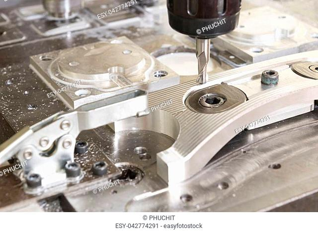 The CNC milling machine cutting the automotive part with the solid ball end mill tool