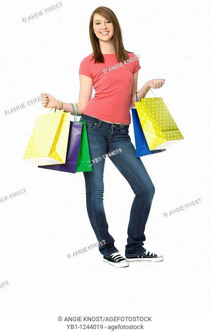Teenage girl with colorful shopping bags