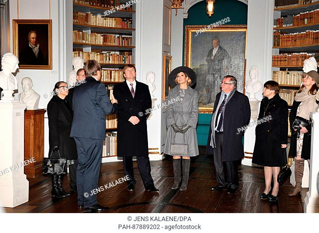 Queen Maxima and King Willem-Alexander (M) of the Netherlands stand in the Duchess Anna Amalia library in Weimar, Germany, 8 February 2017
