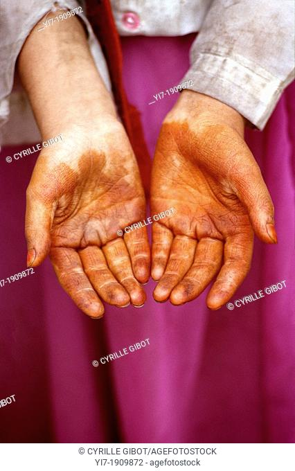 Uighur girl with henna hands, Kashgar, Xinjiang province, China