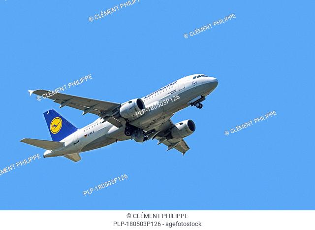 Airbus A319-100, narrow-body, commercial passenger twin-engine jet airliner from Lufthansa German Airlines in flight against blue sky