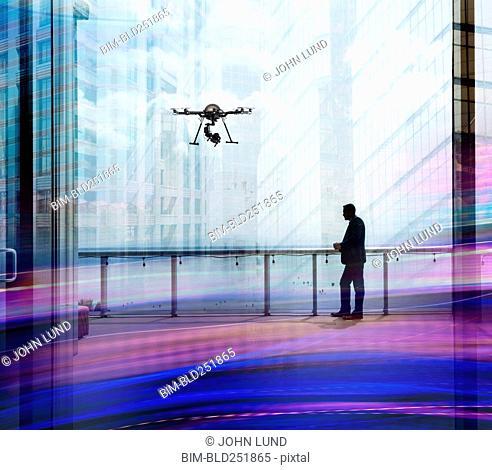 Surveillance drone flying near Caucasian man in internet