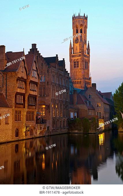 Illuminated Belfry and buildings along Rozenhoedkaai at dusk, historic centre of Bruges, Unesco World Heritage Site, Belgium, Europe