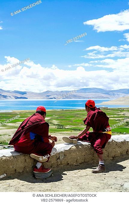 Buddhist young monks watching the views. Nomad summer festival in Tso Moriri lake, Ladakh (India)
