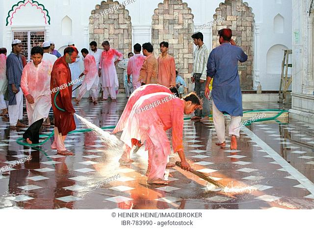 People washing, hosing down the courtyard of a Sufi shrine, Bareilly, Uttar Pradesh, India, South Asia