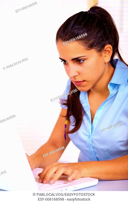Portrait of a pretty business young woman using a laptop
