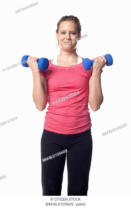 Caucasian woman lifting hand weights