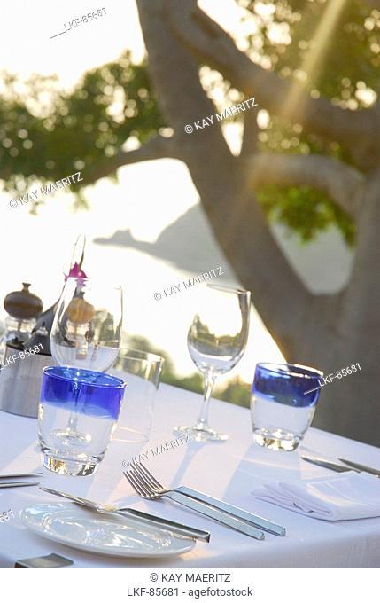 Table with table settings at pool restaurant and sea view, Hotel Pimalai, Ao Kantiang, Ko Lanta, Krabi, Thailand