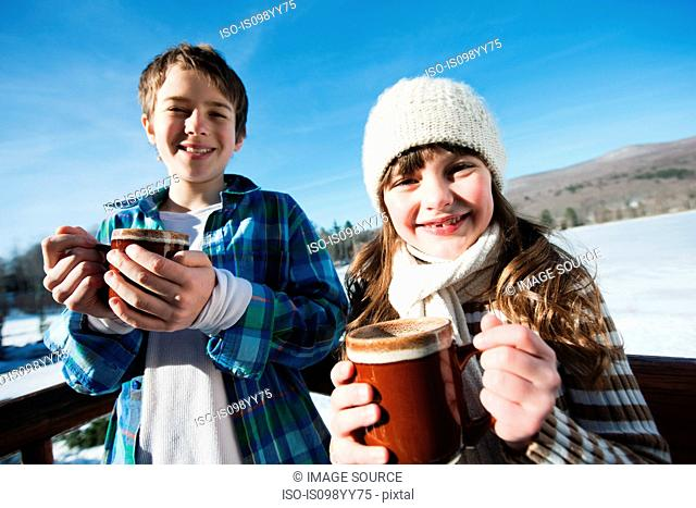 Children with hot drinks, portrait