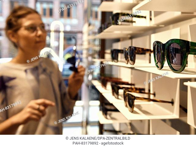 Cora Wollenstein, employee at 'Ace and Tate', arranges glasses in the flagship store of the Dutch glasses brand 'Ace and Tate' in Neue Schonhauser Strasse in...