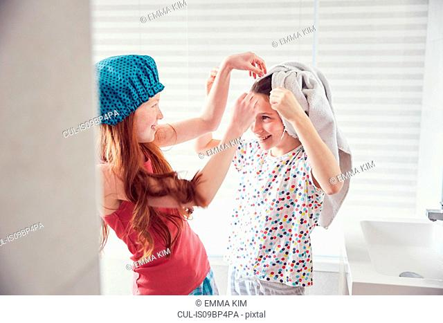Girls playing in bathroom