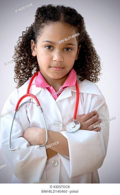 Mixed race girl with attitude playing doctor