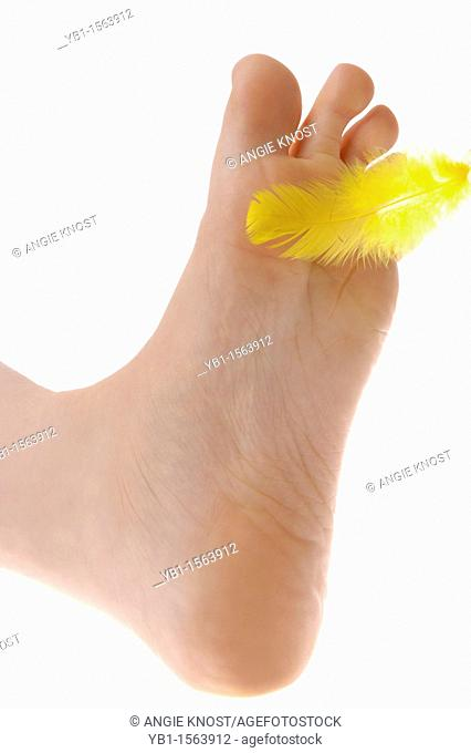 Foot Being Tickled By A Feather