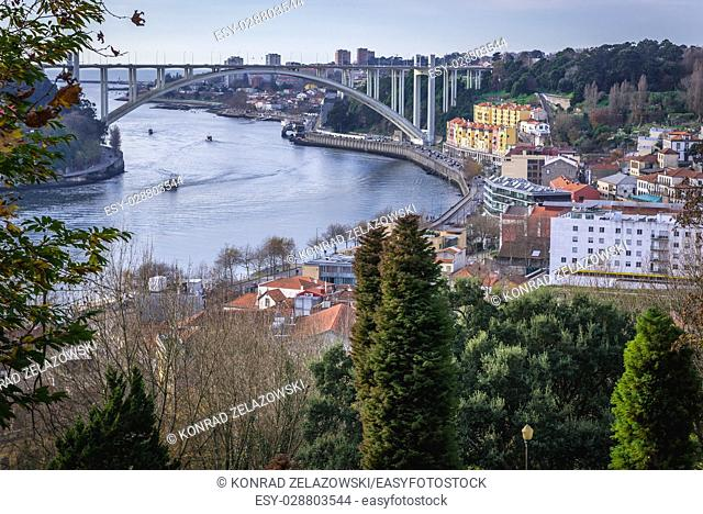 Aerial view from Crystal Palace Gardens with Arrabida Bridge over Douro River connects Porto (on right) and Vila Nova de Gaia cities, Portugal