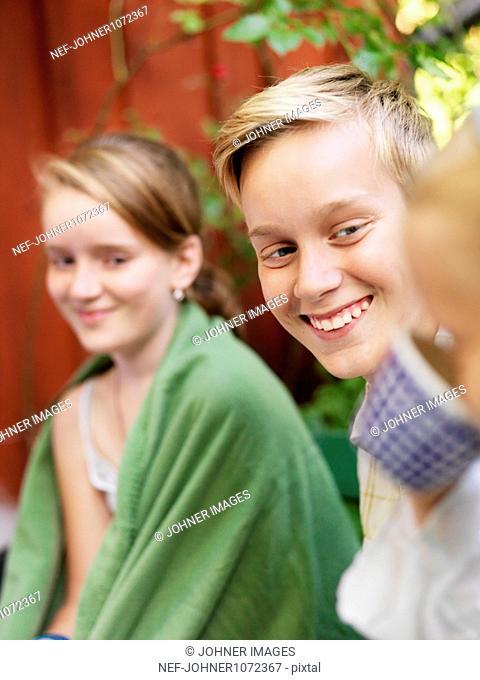 Children sitting in back yard