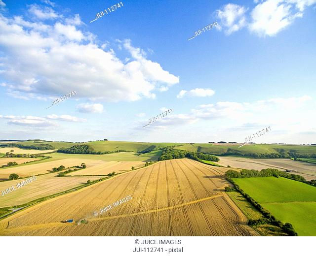Scenic aerial landscape view of barley fields in sunny rural countryside