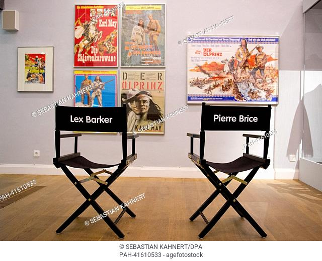 "Two director's chairs sit in front of historic film posters in the exhibition """"Mit Karl May um die Welt"""" (With Karl May around the World) at the Wilhelm Busch..."