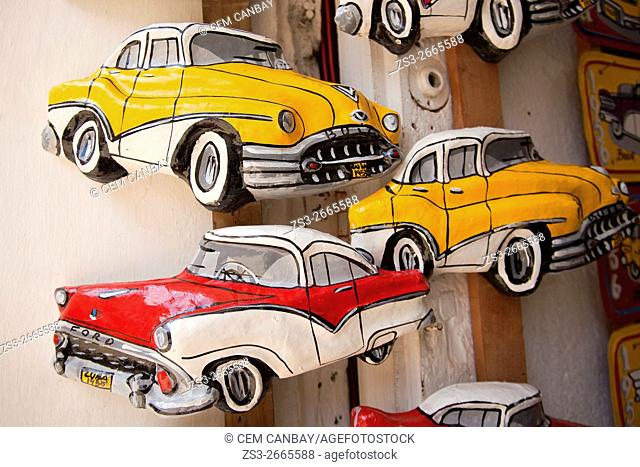 Painted papier mache model cars at the entrance of a shop, Trinidad, Sanctí Spíritu Province, Cuba, Central America