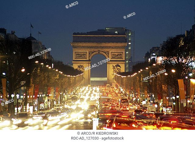 Champs-Elysees and Triumphal Arch in the evening Paris France