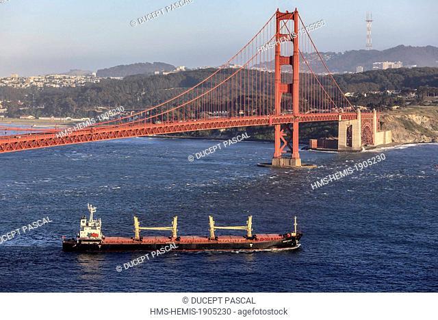 United States, California, San Francisco, Golden Gate National Recreation Area, cargo ship leaving San Francisco Bay and the Golden Gate Bridge